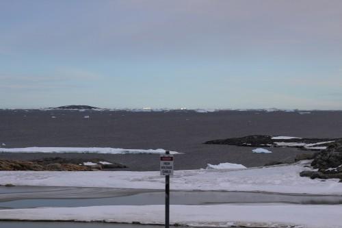 Sun hitting icebergs on the horizon